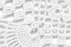 White handmade lace tablecloth texture on white background Stock Photos
