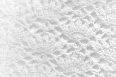 White handmade lace tablecloth texture on white background Stock Photography