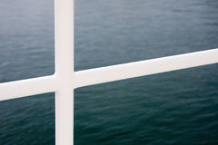 White handrail. On an ocean going ferry royalty free stock images