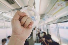 White handrail in subway train stock photo