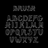 White handwritten calligraphic alphabet on black background. Made in brush style Royalty Free Stock Photography