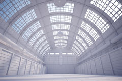 White hangar. With bright sky coming trough the ceiling Stock Image