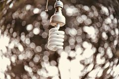 A white hanging electric lightbulb. Isolated object unique royalty free image stock images