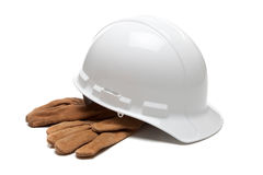White hard hat and leather work gloves on white Stock Photo