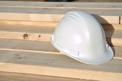 White Hard Hat on Lumber Royalty Free Stock Photos