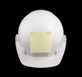 White hard hat and note isolated Stock Images