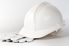 White hard hat and protection gloves Royalty Free Stock Photos