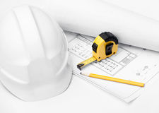White hard hat, tape measure isolated on white Royalty Free Stock Photography