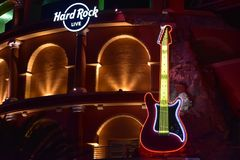 White Hard Rock Sign and Guitar on Colosseum style building at Citywalk Universal Studios Flori stock image
