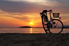 White Hard Tail Bicycle on Brown Beach Sand during Sunsets Royalty Free Stock Photography
