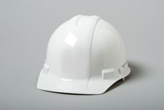 White Hardhat. On grey background Royalty Free Stock Image