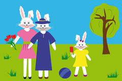 White hares: grandmother, mother and daughter in the park Royalty Free Stock Photos