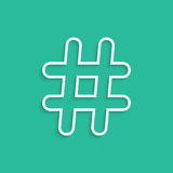 White hashtag icon isolated on green background Royalty Free Stock Images