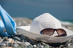 Hat, bag, and glasses on beach Stock Photography