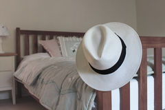 White hat on bedpost Royalty Free Stock Image