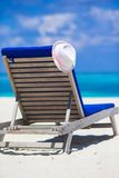 White hat on lounge chair at tropical beach Royalty Free Stock Photo