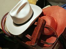 White hat and other headwear in vintage style in the old suitcas Stock Image