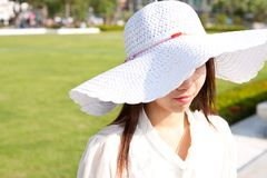 White hat on the thai girl. Thai girl and withe hat in the garden on holiday Stock Photography