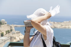 White hatted woman tourist Stock Image