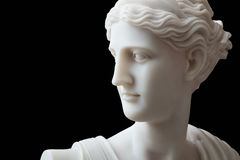 White head marble statue of roman Ceres or greek Demeter. Isolated on black Royalty Free Stock Images