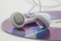 White Headphones on cd Royalty Free Stock Image