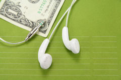 White headphones with dollar Stock Photography