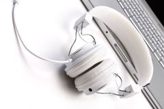 White headphones and laptop. Royalty Free Stock Image