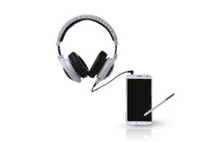 White headphones and smart phone. Royalty Free Stock Photography
