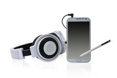 White headphones and smart phone. Royalty Free Stock Photo
