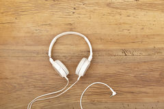 White headphones on wood Royalty Free Stock Images