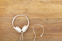 White headphones on wood Stock Images