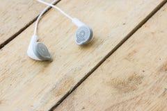 White headphones on wood Stock Photo