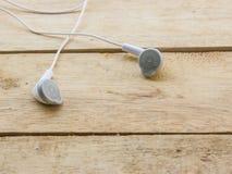White headphones on wood Stock Image