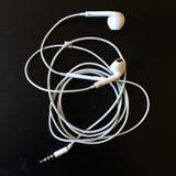 White headset. Speaker isolated on black background Royalty Free Stock Photo