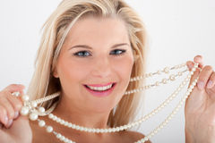 White healthy teeth and pearls Royalty Free Stock Photos