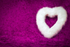 White Heart. Furry white heart on pink background Royalty Free Stock Images