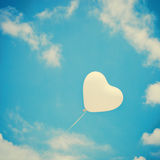 White Heart Balloon. Over turquoise sky royalty free stock photos