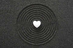 White heart in black sand Royalty Free Stock Photo
