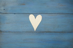 White heart on a blue background, wood painted  Greek blue Royalty Free Stock Photography
