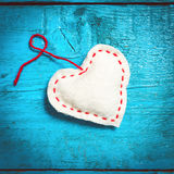 White heart on the blue boards. Valentine`s Day. Colorful knitted hearts. White heart on the blue boards. Valentines day. Heart pendant. Red heart. Valentine Royalty Free Stock Image