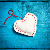 White heart on the blue boards. Valentine`s Day. Colorful knitted hearts. White heart on the blue boards. Valentines day. Heart pendant. Red heart. Valentine Royalty Free Stock Images