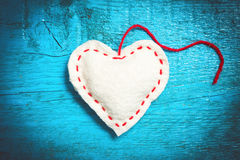 White heart on the blue boards. Valentine`s Day. Colorful knitted hearts. White heart on the blue boards. Valentines day. Heart pendant. Red heart. Valentine Stock Photos