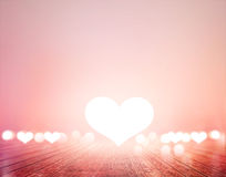 White heart and bokeh on wooden floor vibrant for background, soft and blur for background Royalty Free Stock Images