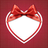 White heart border frame with red ribbon bow on red Royalty Free Stock Images