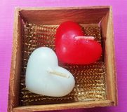 White Heart Candle and Red Heart Candle Royalty Free Stock Photos