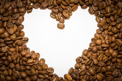 White heart created from coffee beans.  royalty free stock photos