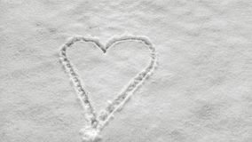 White heart doodle in snow royalty free stock images