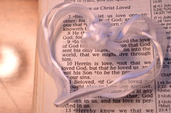 White Heart with First John 4:10 royalty free stock photos
