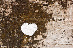 White heart floating on the surface of old plaster walls Stock Photos