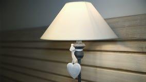 White heart on a floor lamp stock video